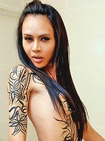 Ladyboy with large tattoo and massive cock