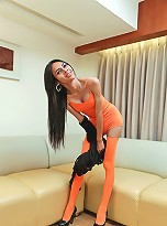 Mint wanks her monster shemale cock in orange