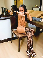 Dazzling ladyboy in lacy stockings and high heels