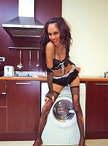 T-girl in torn fishnets shows cooking master-class