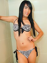 Watch this hung Asian tranny get boned