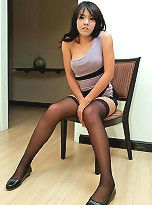 Young ladyboy jerks off in her stockings