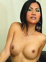 Asian ladyboy on couch gets rock hard for the camera