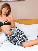 Asian ladyboy Cindy tenderly stroking her pecker