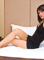 Ladyboy Dewl showing off in a black cocktail dress