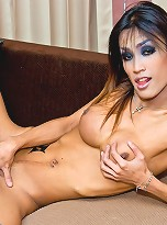 Shemale seductress Icecy in a teddy and jackboots