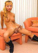 Blonde ladyboy Sindi shows her erect dick close-up
