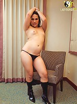 Stacked tranny Bell readily spreads her ass cheeks
