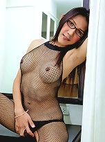 Ladyboy in glasses with huge firing cock