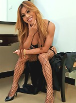 Ladyboy wanks her cock in hot PVC