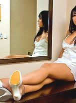 Busty t-girl Eye posing in white undies and heels