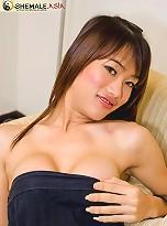 Asian t-girl Bee taking fun from fondling her body