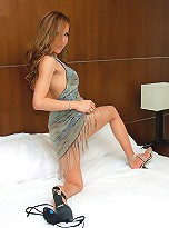 Sultry t-girl Vikky clad in a fancy gown and heels