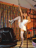 Ladyboy clad in all-white with matching stockings