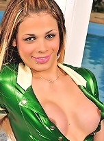 Hot shemale teases in a green latex uniform