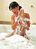Hot shemale gets all soapy in the tub