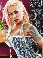 Petite Tranny with tattoos and blonde hair to her ass