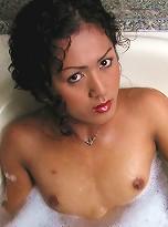Pretty Thai Ladyboy plays in the bubble bath