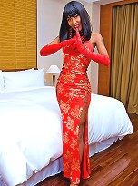 Drop dead gorgeous tranny Areeya poses and bends over in the bed