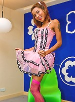 Frisky t-girl in cute outfit stuffing her sex toy