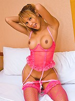 Pretty shemale posing sexy in a skimpy pink outfit