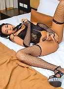 Seductive ladyboy clad in lace licking high heels