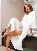 Leggy dick-girl teasingly drops down her bathrobe
