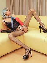 Glam Rock ladyboy stokes her spunky pole