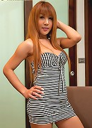 Shemale redhead Pour peeling off her stripy dress