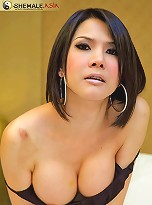 Bigtitted tranny Layla in her short clinging dress