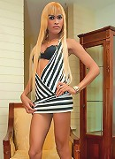 Blonde shemale Fa strips off her sexy stripy dress