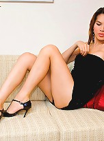 Leggy t-girl Jene poses sexy in a mini black dress