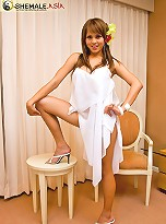 Asian shemale lovely Sandi posing in a white tunic