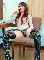 T-girl Angel in net bodystocking and leather boots