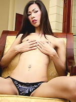 LadyboyLadyboy\'s November Girl of the Month, Oil, does not match her name. Ladyboy Oil is smooth to the touch and soft in your mouth. Her tits are small and parky, but her cock is fat and rockhard.