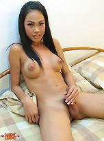 Cute, girls Thai ladyboy with rock hard cock and spread ass.