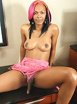 Hot babe with long pink hair and a long black dick!