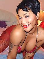 Tattooed goddess Pocahontas just can\'t keep her massive melons in the little red bikini!