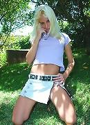 Blonde Brazilian babe Dany strips outside