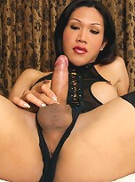 Lek is a kinky ladyboy who loves fetish wear. Her favorite outfit is the one she\'s wearing because men have easy access to her milky white tits.