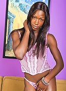Pretty ebony shemale shows off her big tool