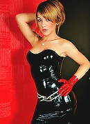 Stunning latex clad shemale