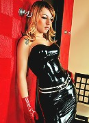 Redhead ts beauty in black latex