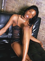 Stunningly sexy chocolate tgirl posing her sweet cock