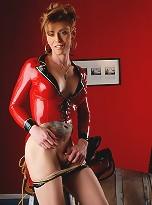 Naughty Jasmine posing in devilishly red latex costume