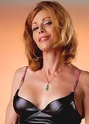Hot Jasmine Jewels posing in latex costume
