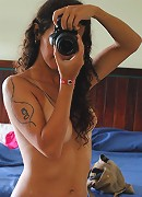 Sexy tgirl Nicole shooting nude pictures of herself