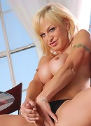 Sweet TS blonde having coffee and stripping