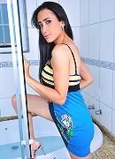 Brunette transsexual beauty posing in the bathroom