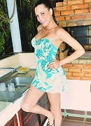Big breasted tgirl getting naked in the kitchen